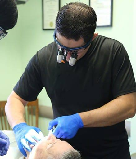 glenpool dentist with CCCD shirt on