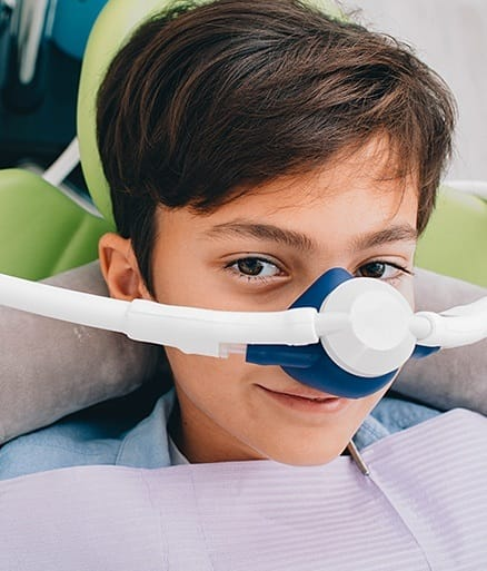 young boy with nitrous oxide mask on