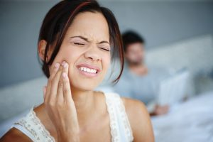 young woman in dental pain