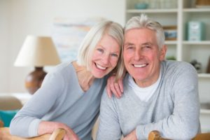 elderly couple smiling with dentures in Glenpool