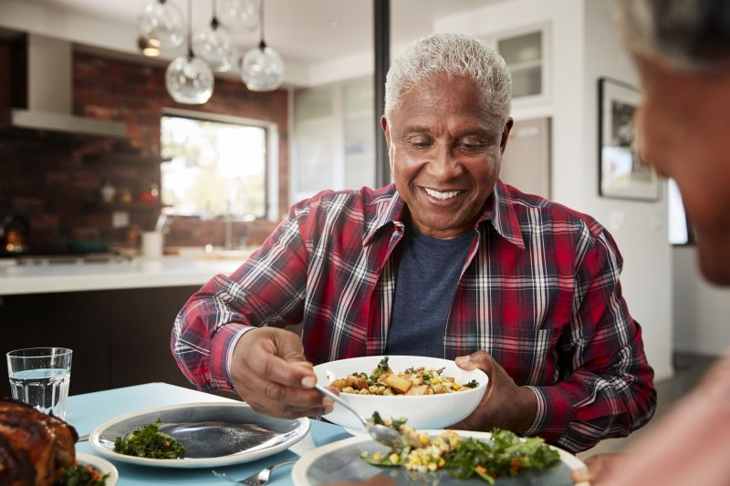 Senior man filling his bowl with food