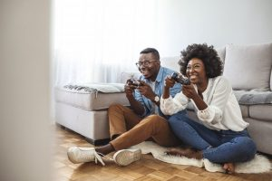 a couple playing video games and hanging out in a living room